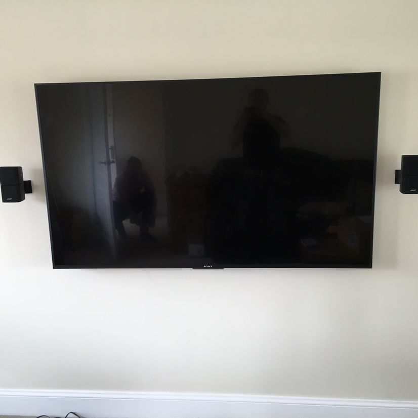 Wall mounted television with speakers